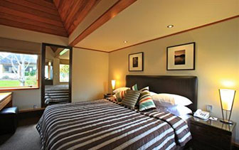 Oceania New Zealand Distinction Te Anau Hotel & Villas guest bedroom - luxury vacation destinations