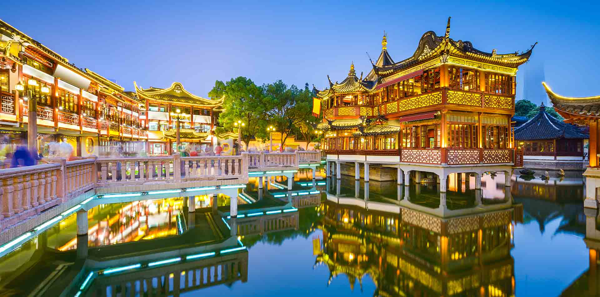 Asia China Shanghai traditional Chinese courtyard with temples at nighttime - luxury vacation destinations