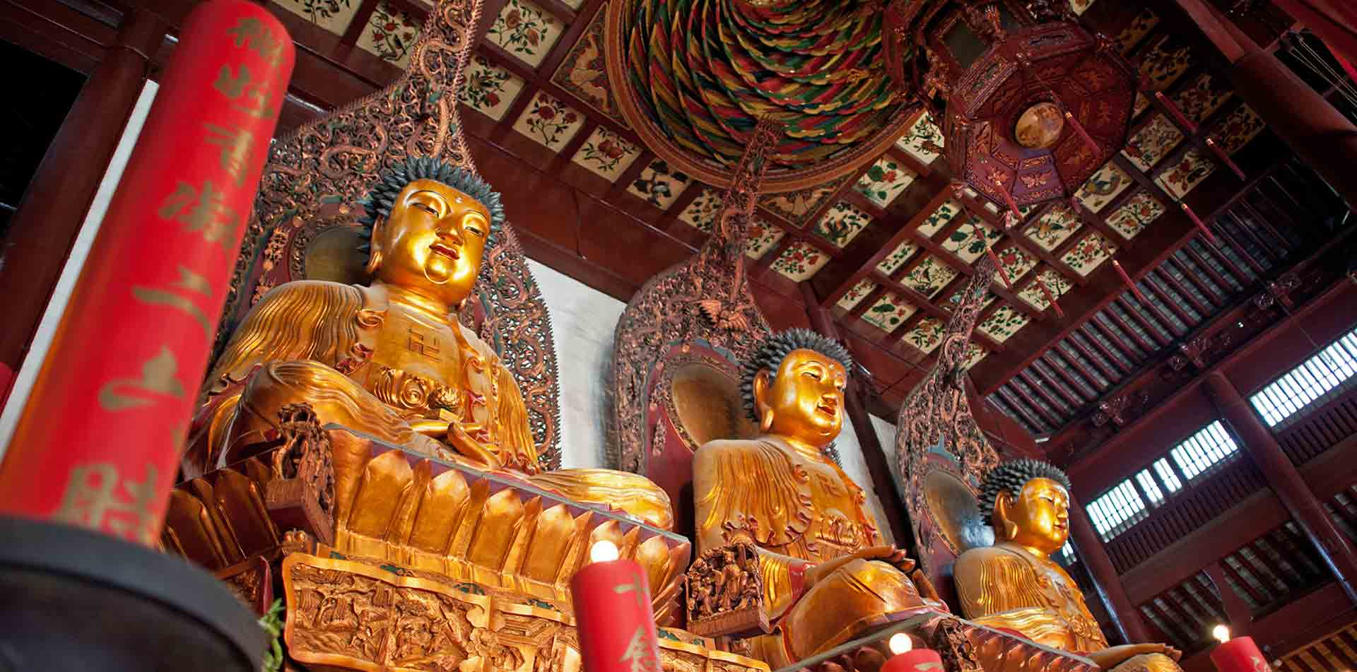 Asia China Shanghai Jade Buddha Temple monastery with three large Buddha statues - luxury vacation destinations