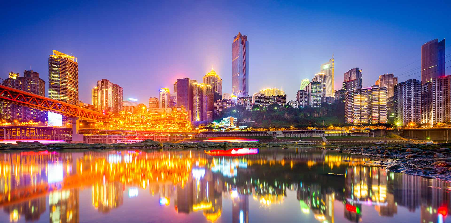 Asia China Yangtze and Jialing rivers in Chongqing with cityscape at night - luxury vacation destinations