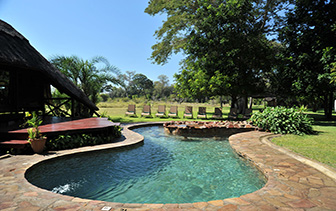 Africa Zambia Livingstone Mosi-O-Tunya National Park Thorntree River Lodge lush exterior pool - luxury vacation destinations