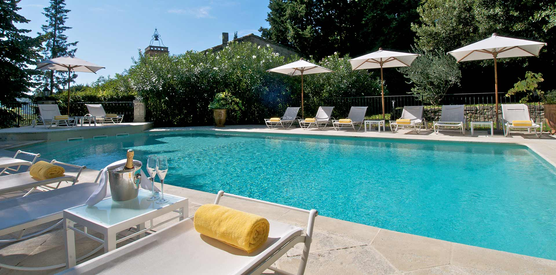 Europe France Provence Chateau de Varenne hotel outdoor pool lounge - luxury vacation destinations