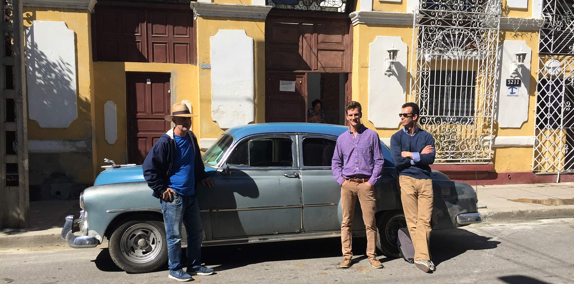 Edward and Jack Piegza with Classic Cars in Havana, Cuba