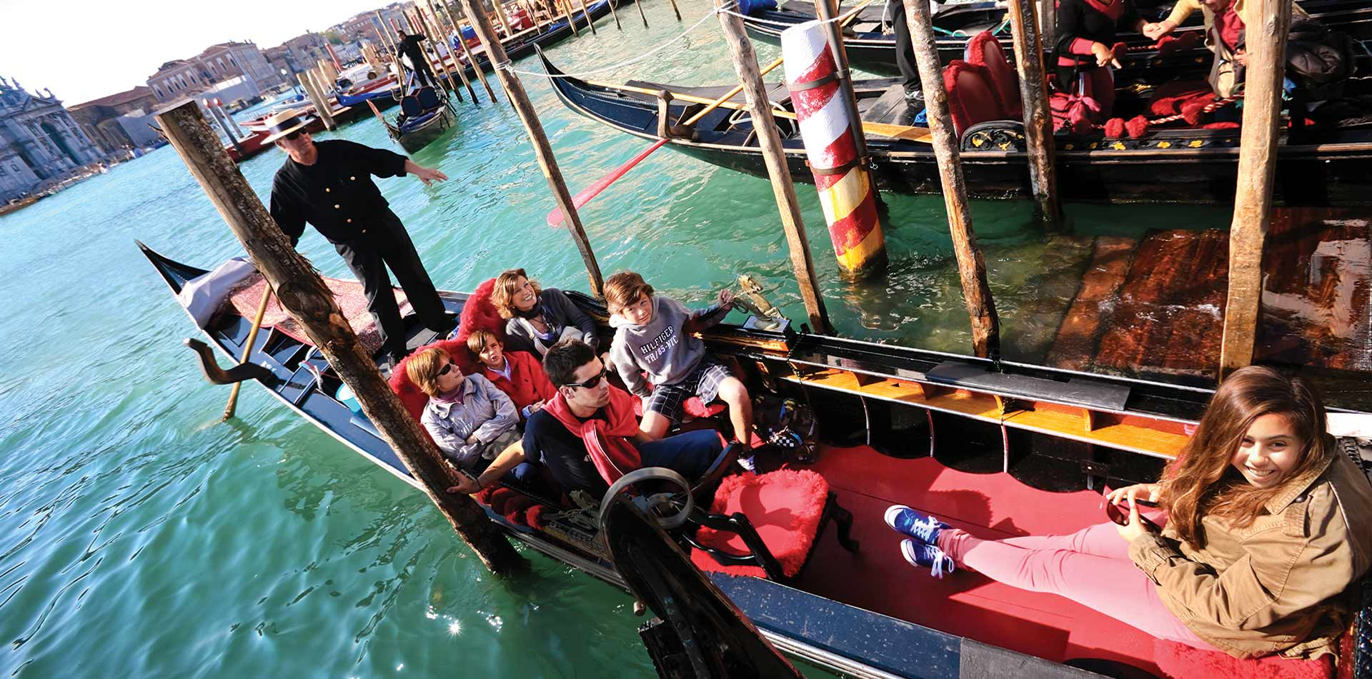 Family on gondola in Venice, Italy