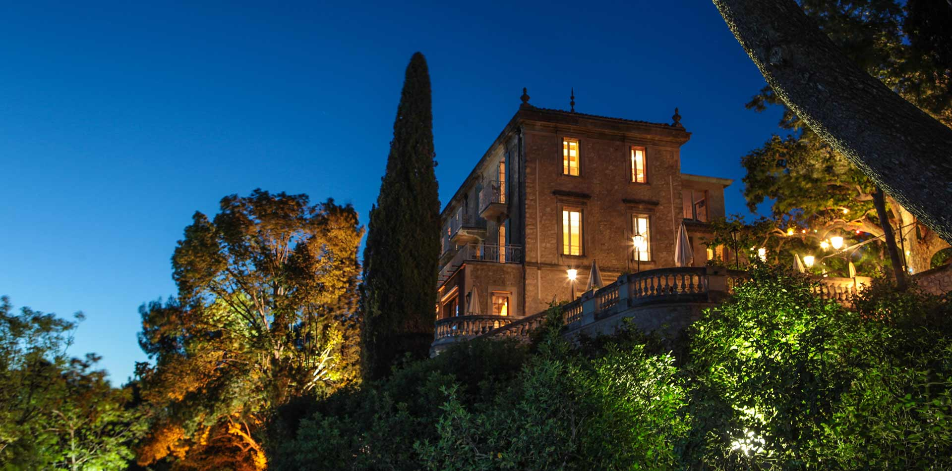 Europe France Avignon Auberge de Noves hotel exterior view at night from gardens - luxury vacation destinations