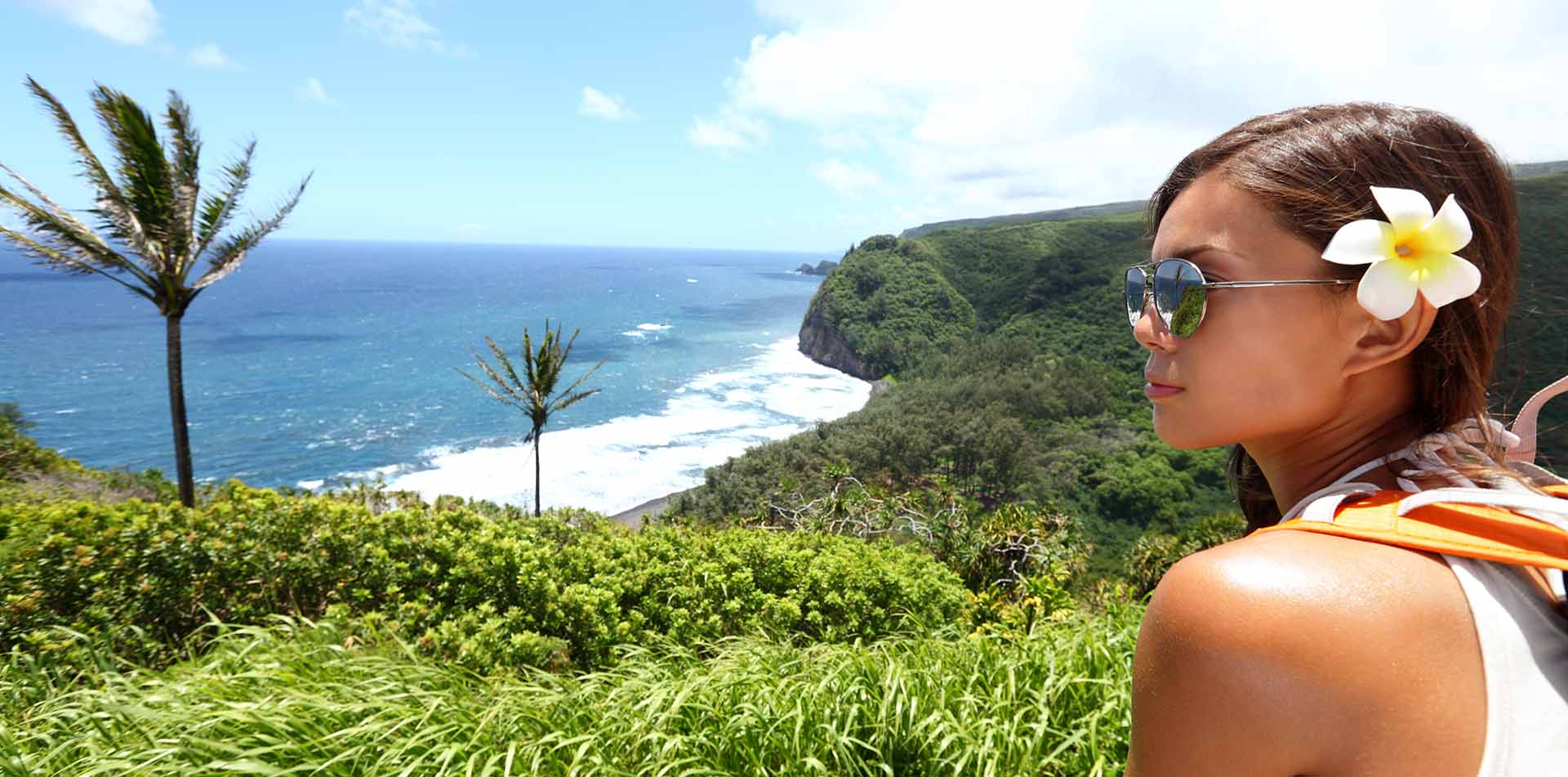 North America United States Hawaii scenic lush landscape blue water young woman looking - luxury vacation destinations