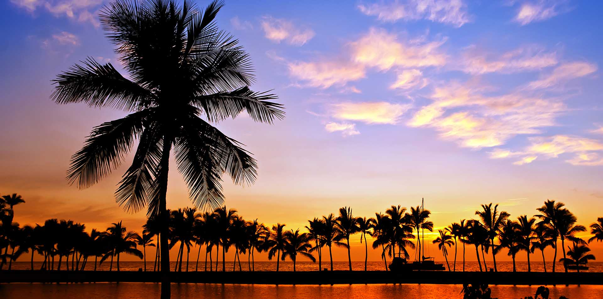 North America United States Hawaii beautiful Anaehoomalu Bay orange sunset palm trees tropical - luxury vacation destinations