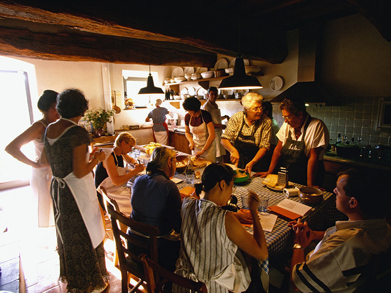 Europe Italy Florence group of travelers and local chefs in private home cheese making - luxury vacation destinations