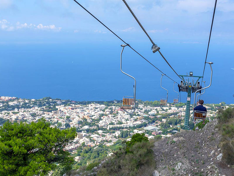Europe Italy Amalfi Coast chairlift on Capri island overlooking the ocean - luxury vacation destinations
