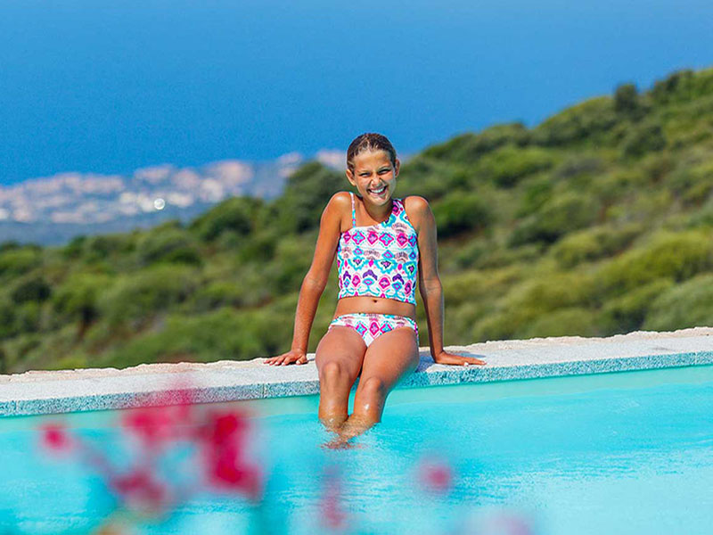 Girl Relaxing by Pool, Family Journeys