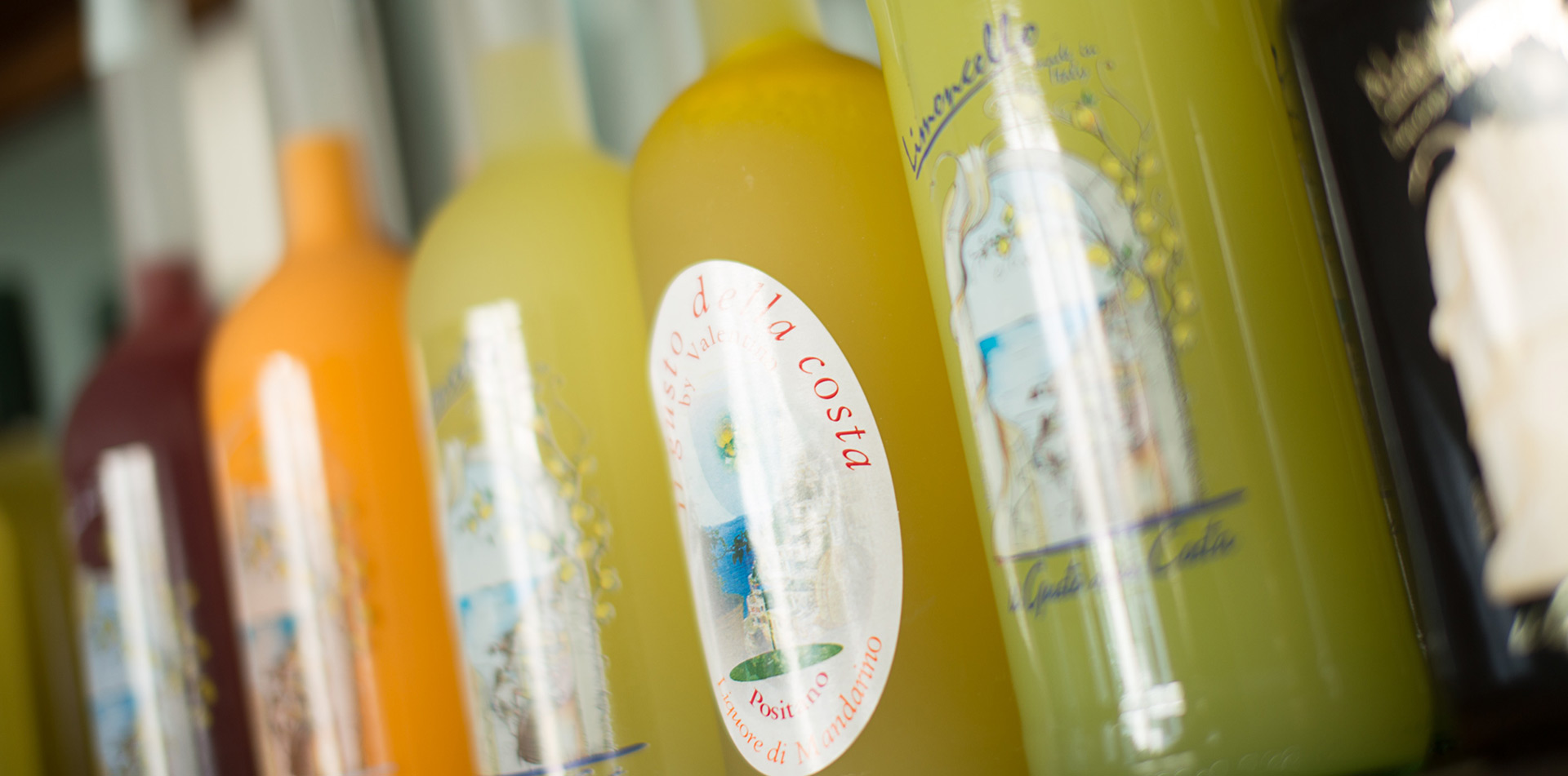 Europe Italy Amalfi Coast Positano fresh lemon bottled limoncello for sale in local store - luxury vacation destinations