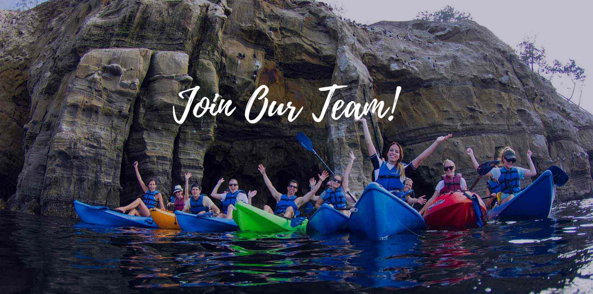 Classic Journeys team kayaking in La Jolla cove sea caves	Join Our Team