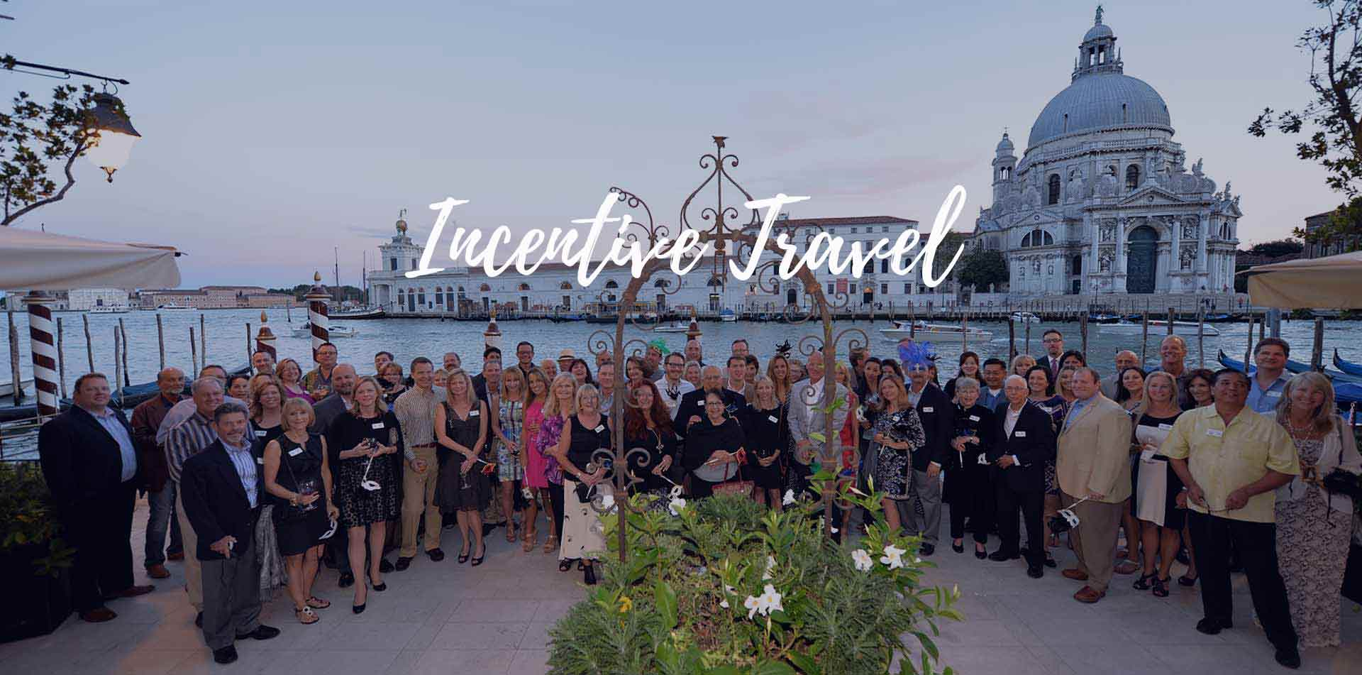 Group of travelers gathered for a photo affinity alumni incentive travel - luxury vacation destinations