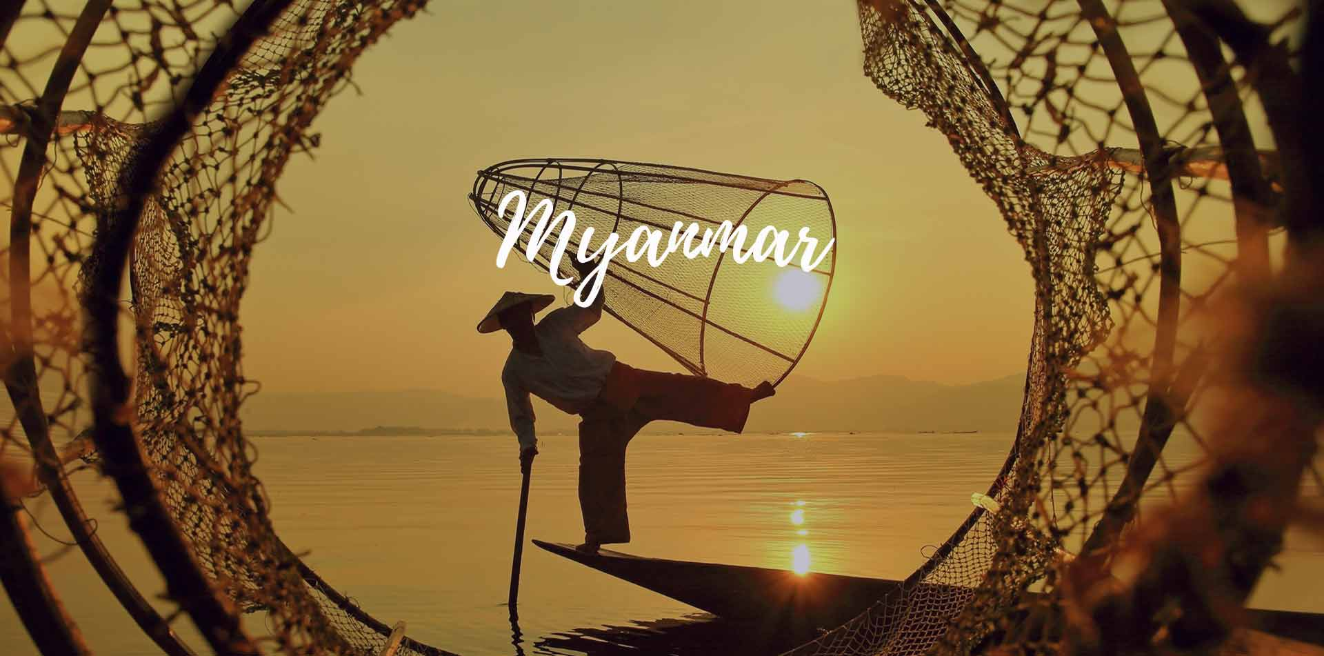 Asia Myanmar local fisherman balancing on boat with fishing net traps - luxury vacation destinations