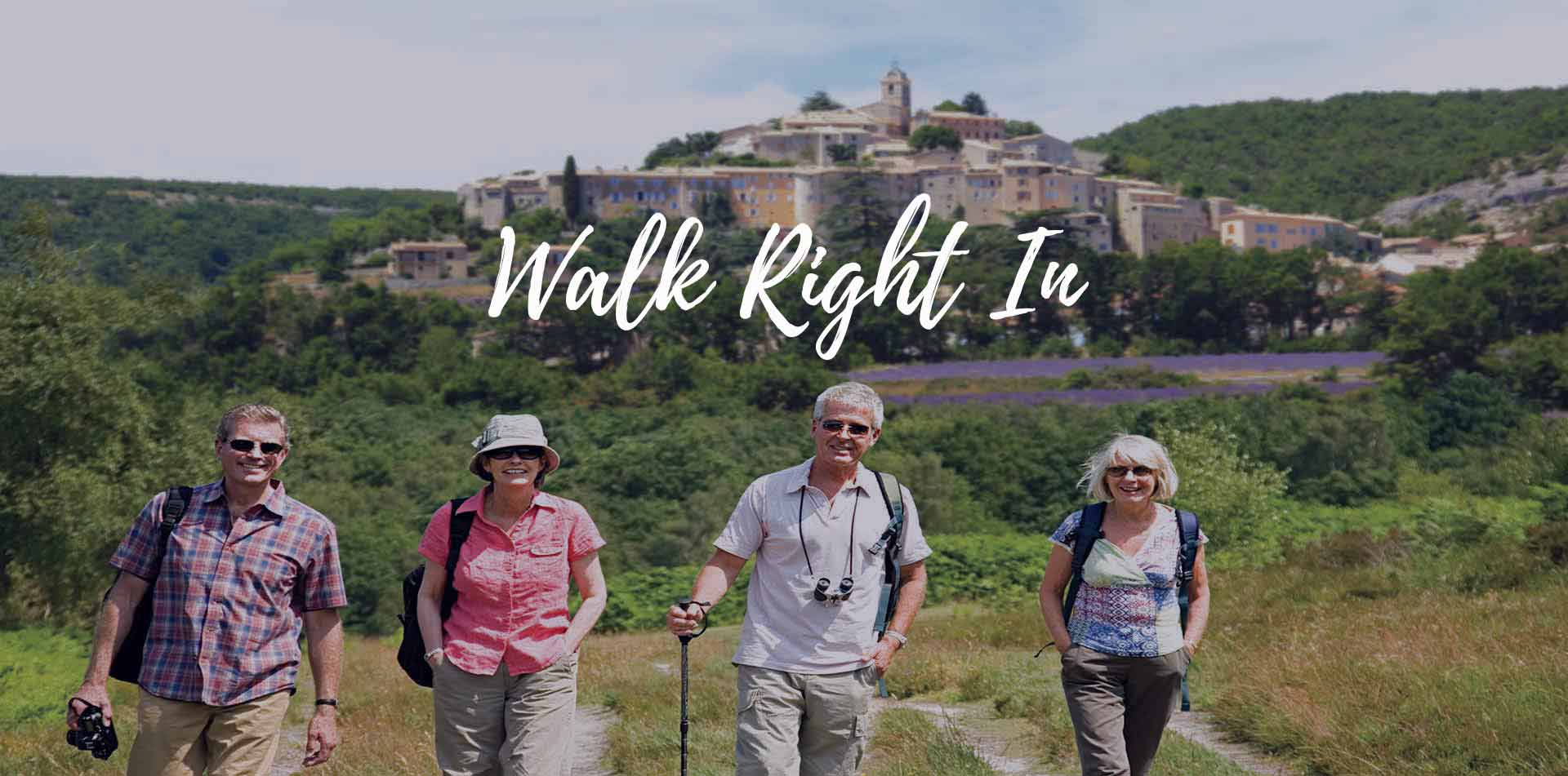 Europe France Bordeaux and Dordogne Valley travelers in field walk right in - luxury vacation destinations
