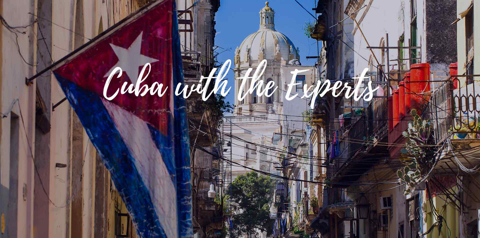 North America Caribbean Havana Cuba with the experts Cuban flag old street El Capitolio view - luxury vacation destinations