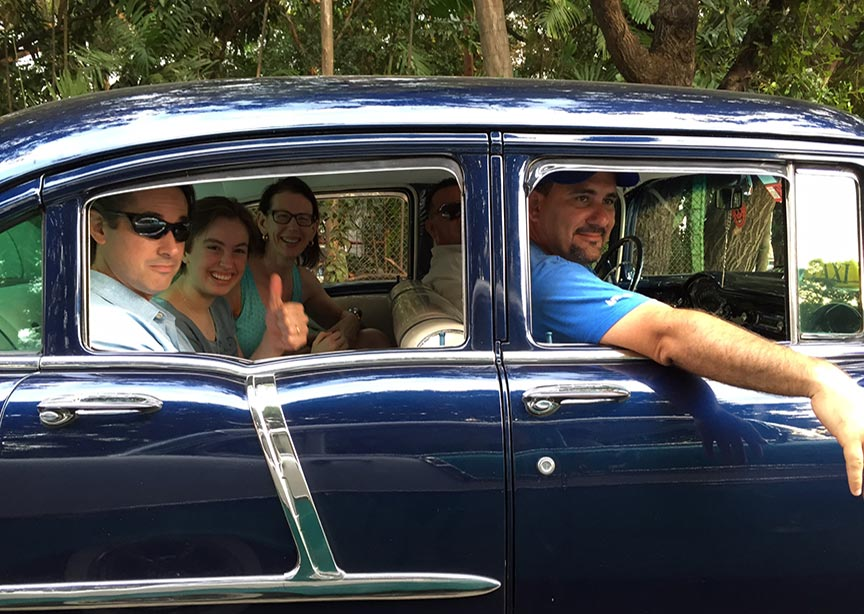 Family in a car in Havana, Cuba
