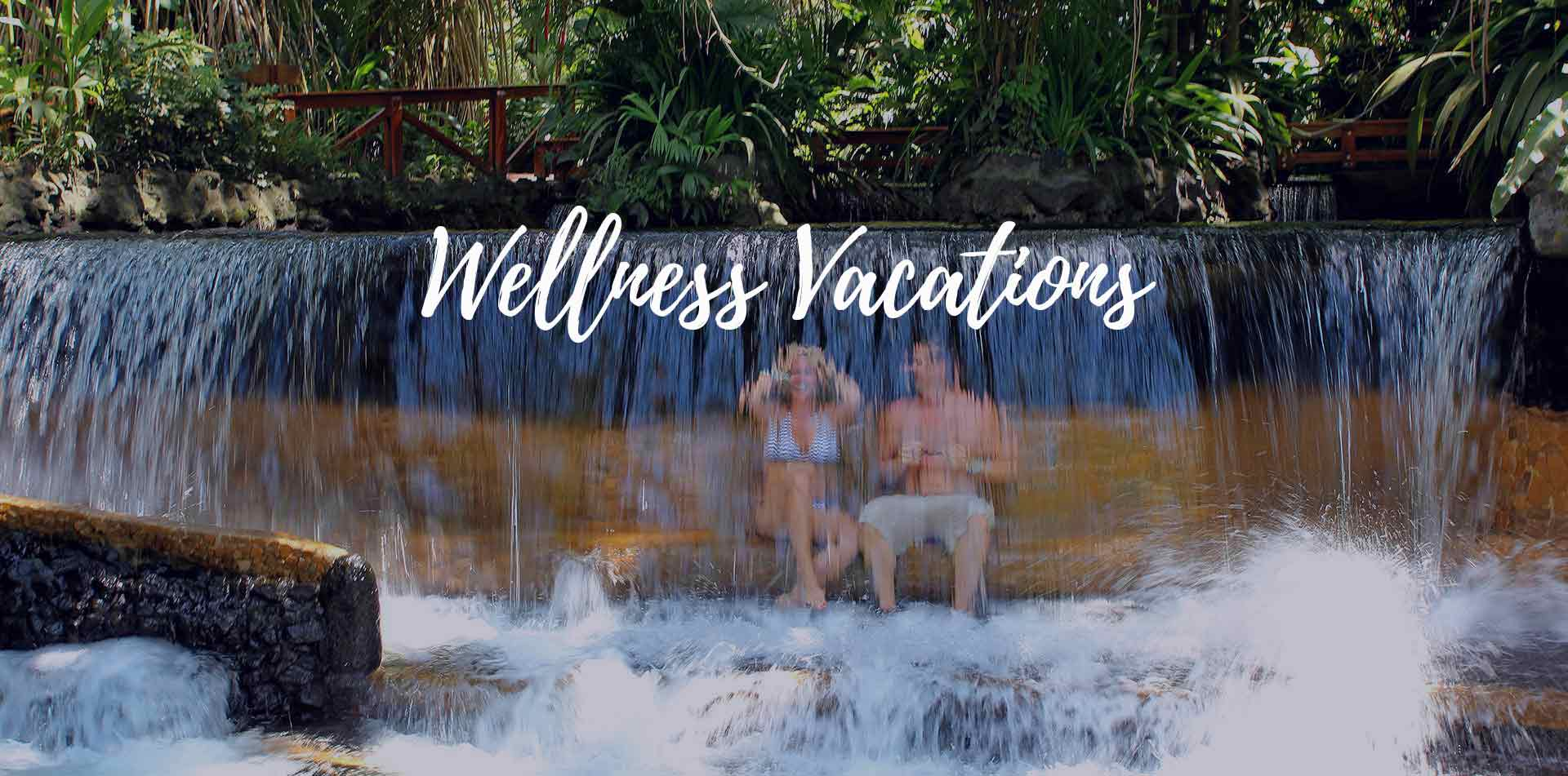 Central America Costa Rica Arenal Tabacon Grand Spa Thermal Resort couple waterfall wellness vacations - luxury destinations
