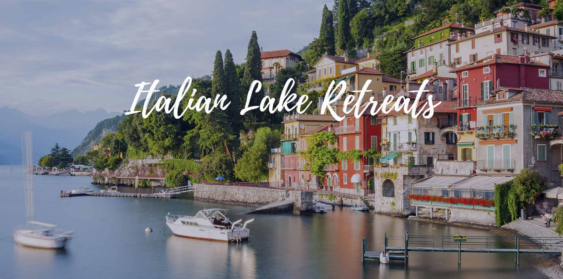 Europe Italian Lake Retreats Menaggio scenic town boats historic colorful houses lush hillside - luxury vacation destinations