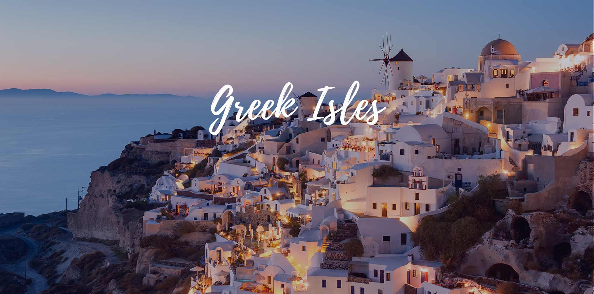 Europe Greece Santorini white buildings on cliffside overlooking ocean Greek Isles - luxury vacation destinations