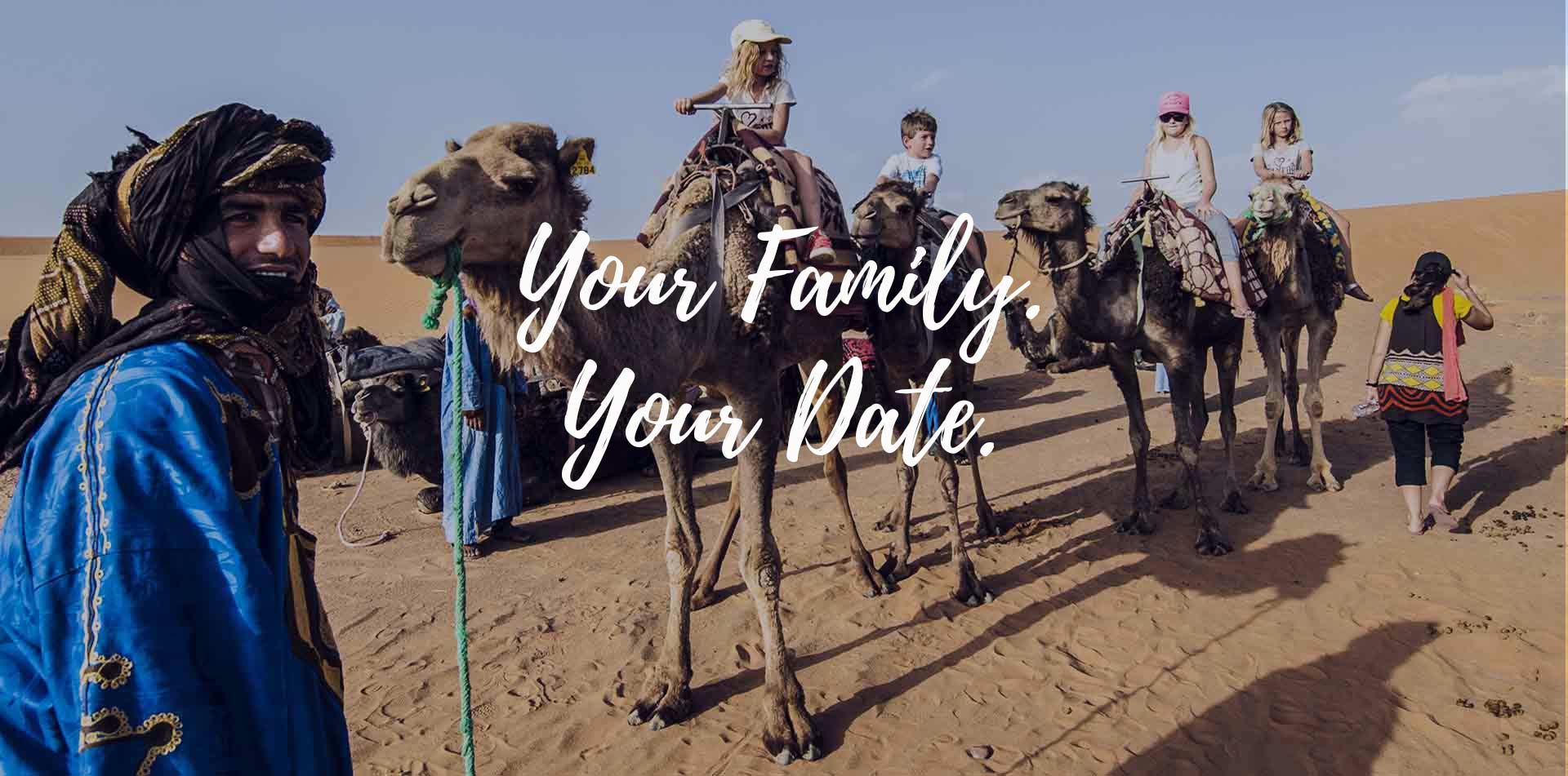 Africa Morocco Your Family Your Date children riding camels in the Sahara Desert - luxury vacation destinations