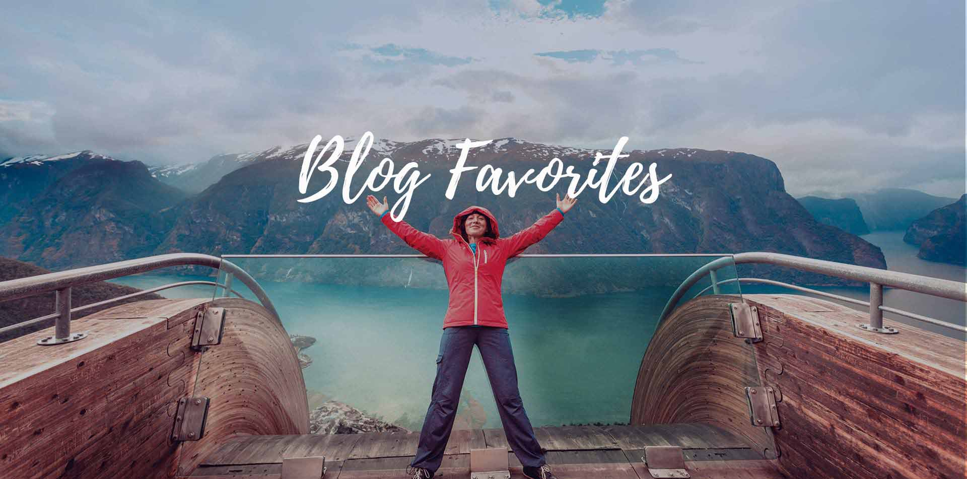 Europe Norway woman in red jacket leaning over the edge of a fjord Blog Favorites - luxury vacation destinations