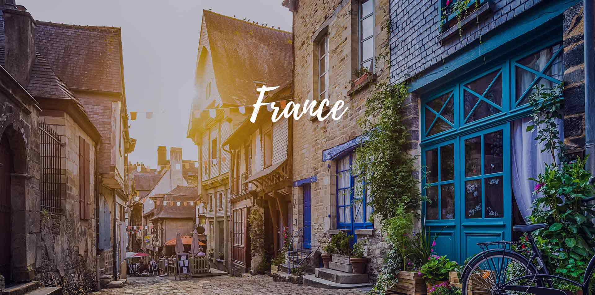 Europe France Brittany old historic town at sunset cobblestone streets bright colored doors - luxury vacation destinations