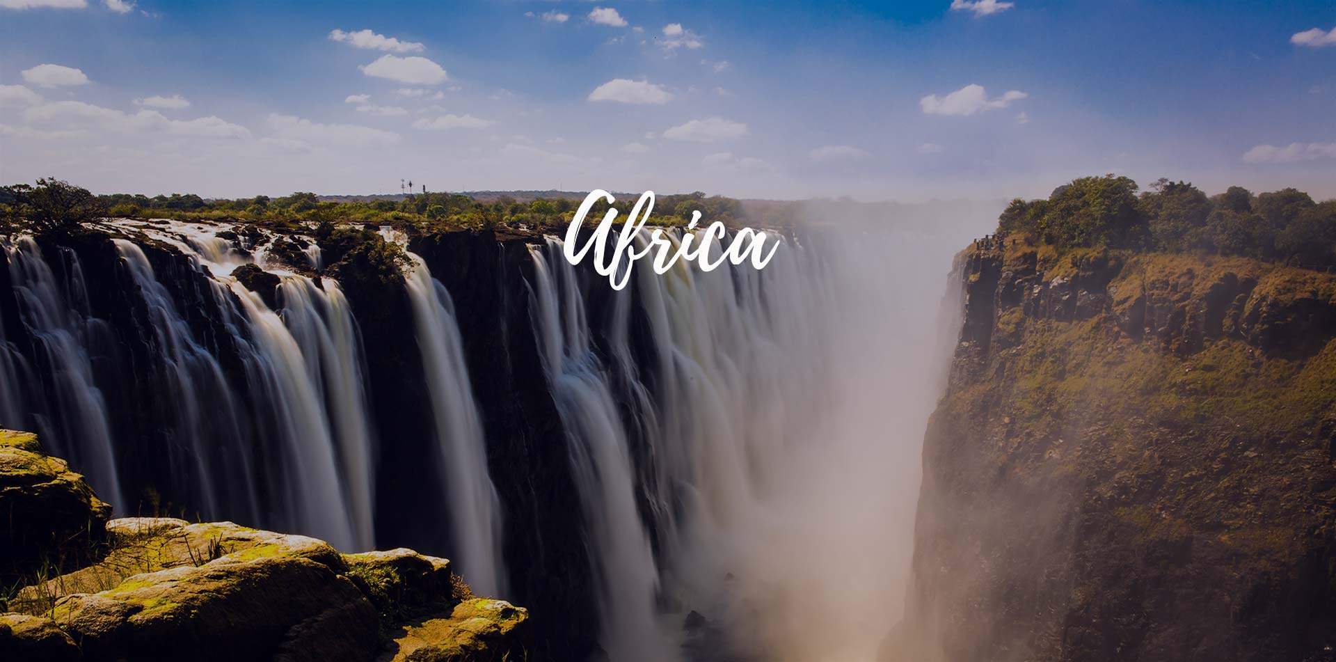 Africa Zambia scenic Zambezi River spectacular Victoria Falls rocky cliffs lush jungle - luxury vacation destinations