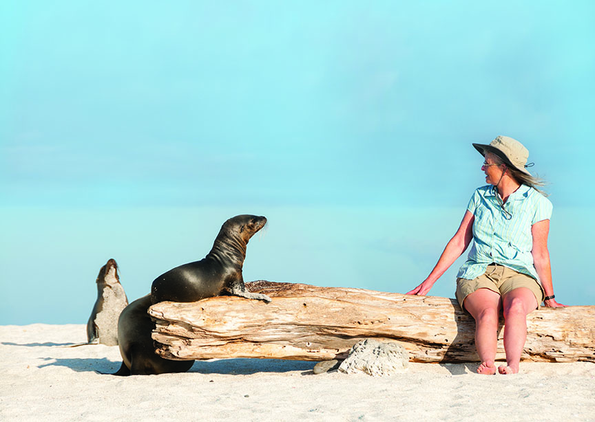 Woman and Sea Lion on Log, Galapagos Islands