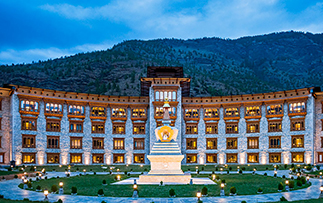 Asia Bhutan Le Meridien Paro Riverfront hotel exterior view at dusk - luxury vacation destinations