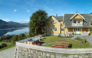 Europe Norway Hafslo BesteBakken exterior view of hotel and fjord during summer - luxury vacation destinations