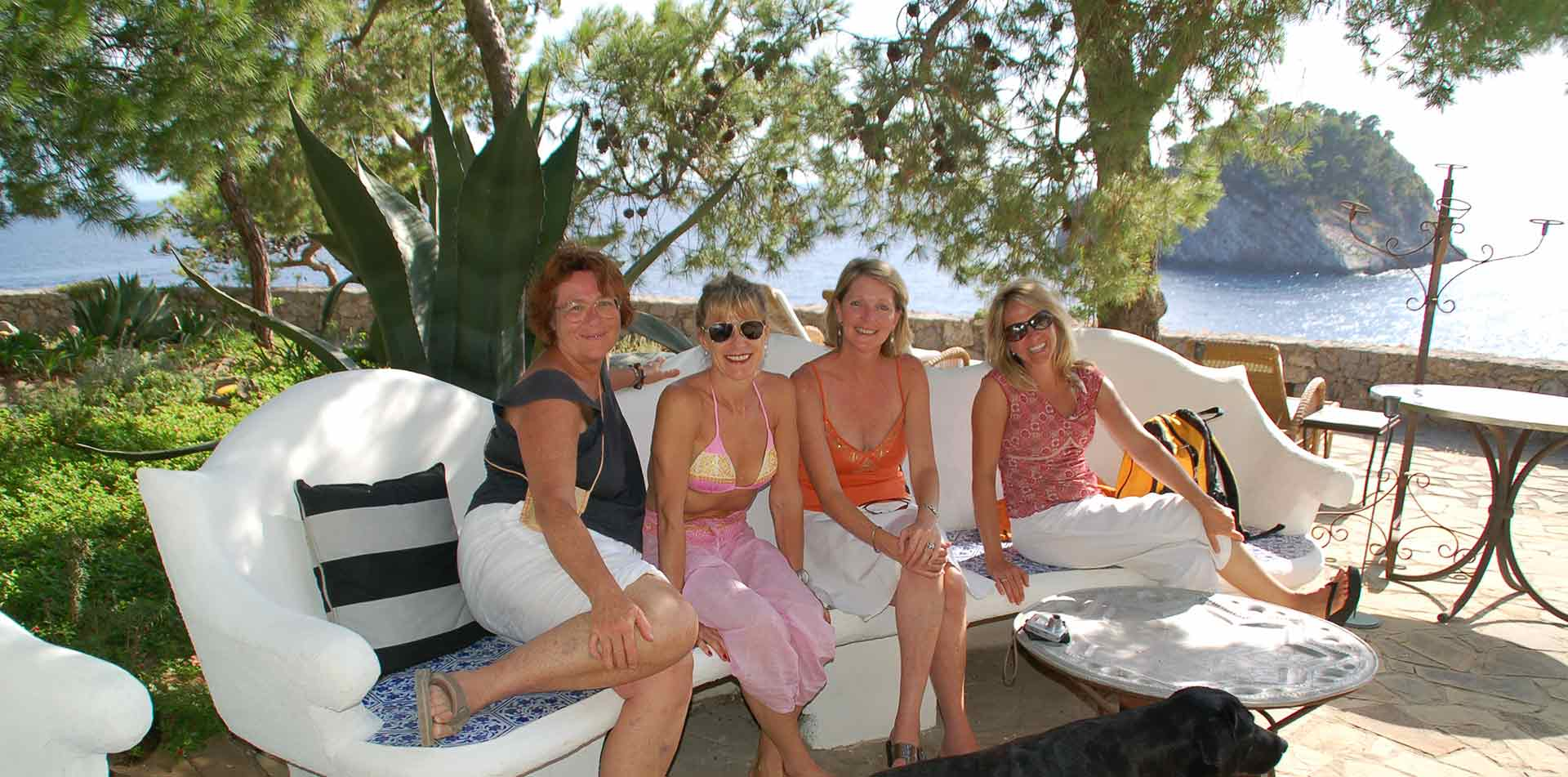 Europe Italy group of women enjoying the patio with a beautiful coastline in the background-luxury vacation destinations