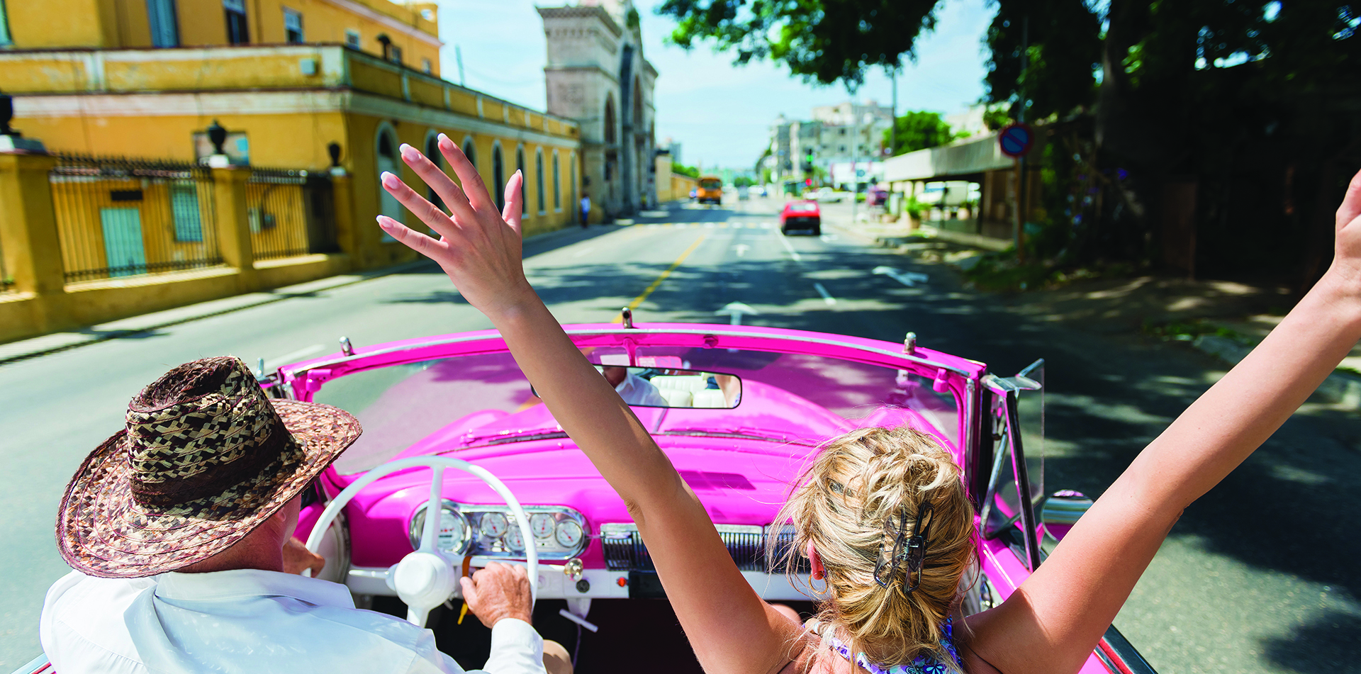 North America Caribbean Cuba classic convertible car pink woman fun drive local street - luxury vacation destinations