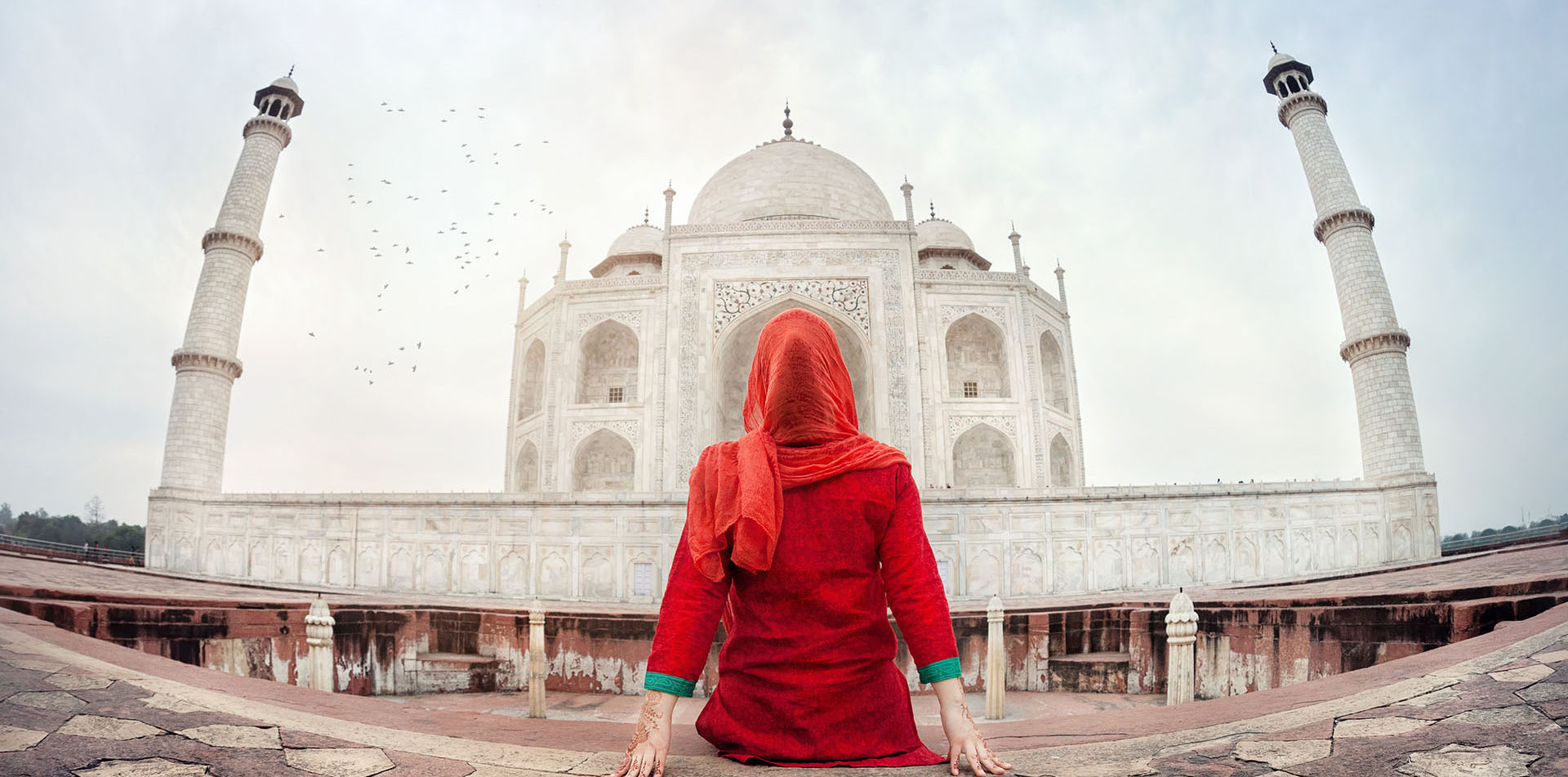 Woman sitting in front of Taj Mahal, India