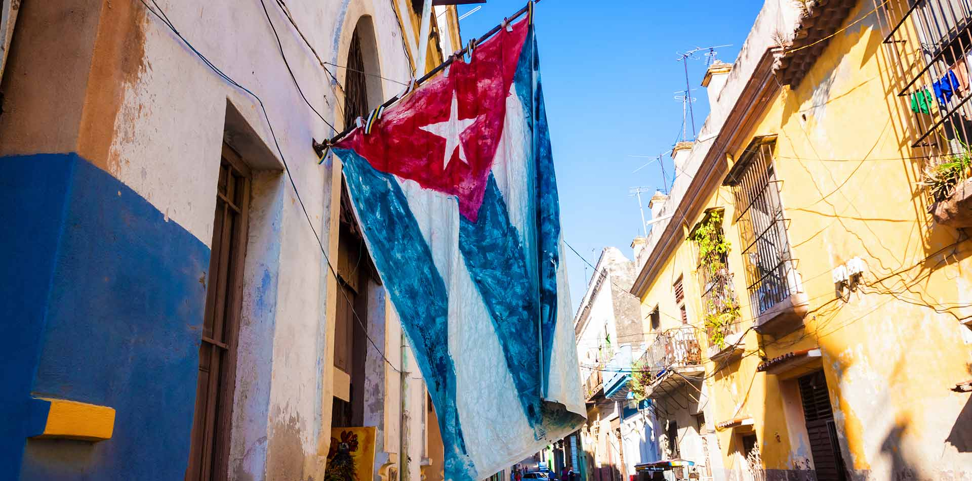 North America Caribbean Cuba Havana old street flag art Almost Famous Gallery - luxury vacation destinations