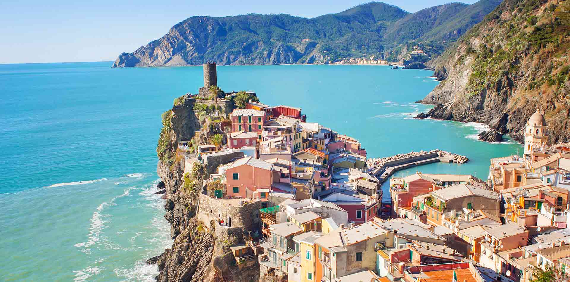 Europe Italy Cinque Terre aerial view of colorful village of Vernazza overlooking the sea - luxury vacation destinations