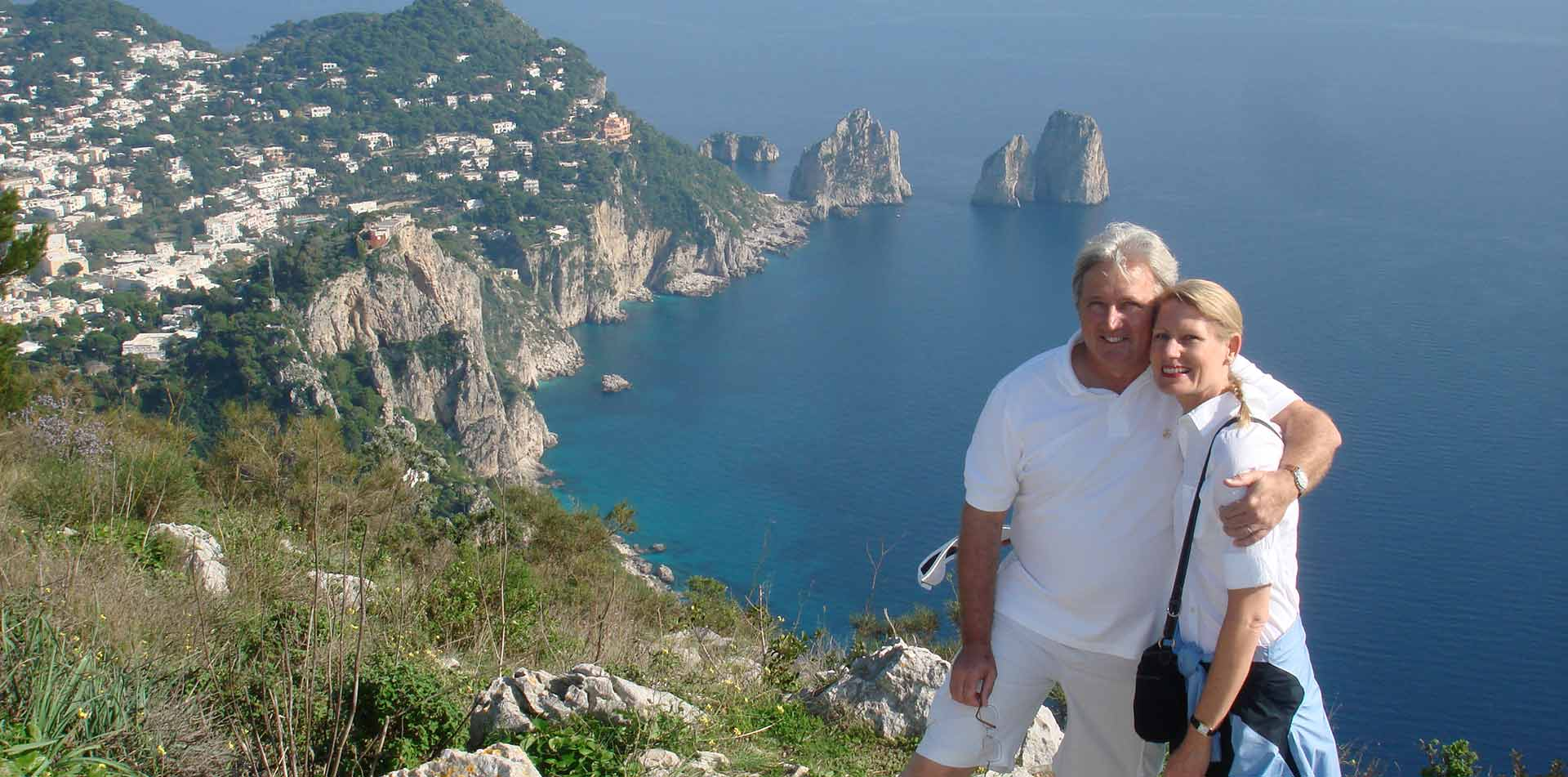 Couple posing in front of Amalfi Coast, Italy