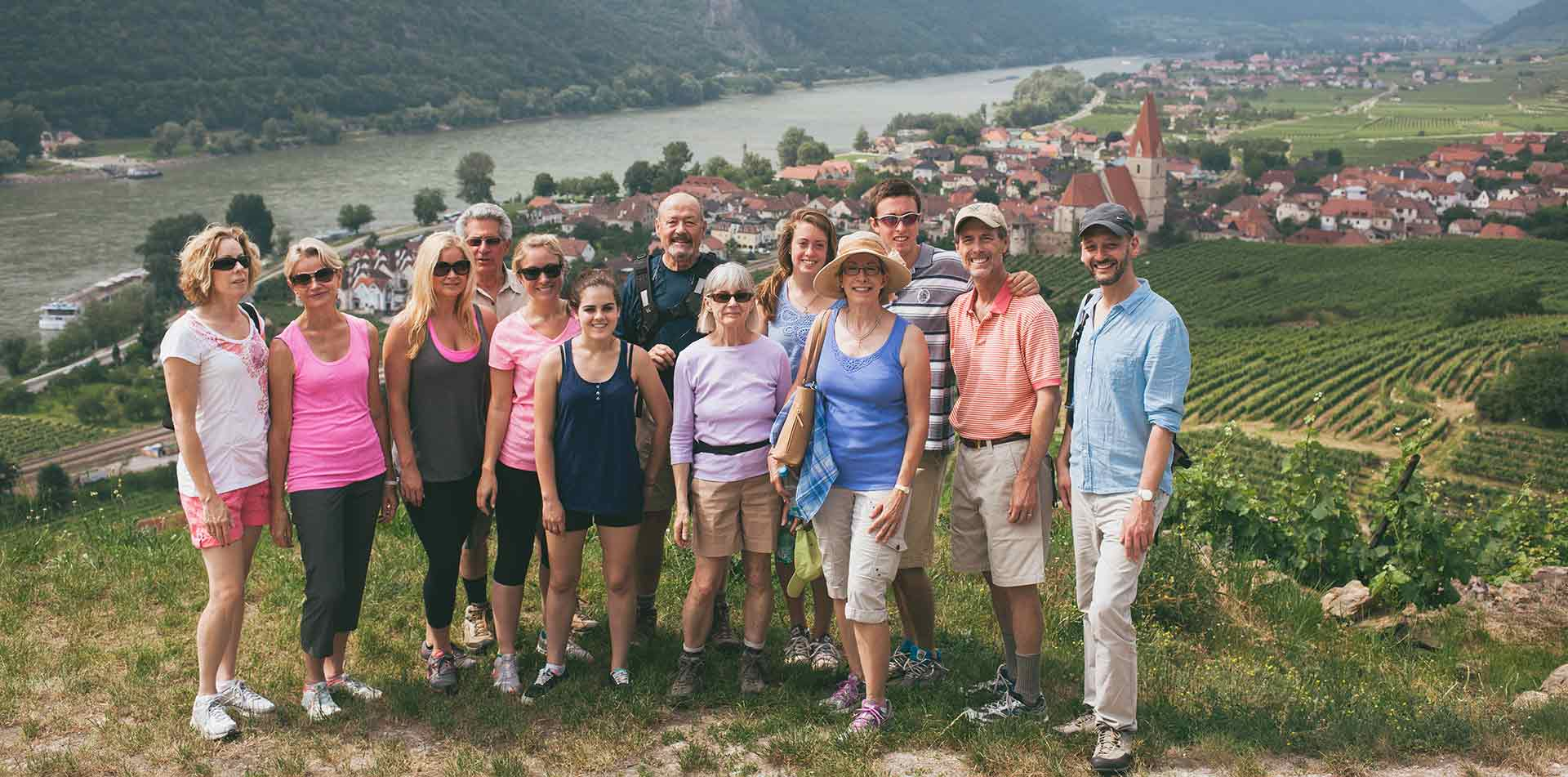 Europe Czech Republic group of travelers posing for photo on village hillside - luxury vacation destinations