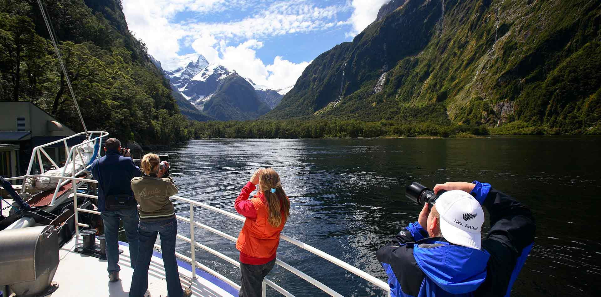 People taking pictures of Milford Sound