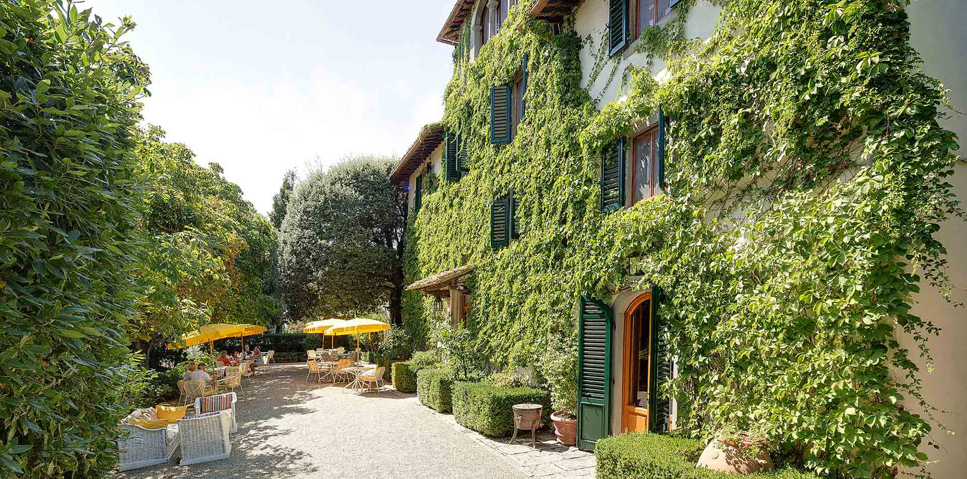 Europe Italy Panzano in Chianti Villa Le Barone garden with ivy walls - luxury vacation destinations