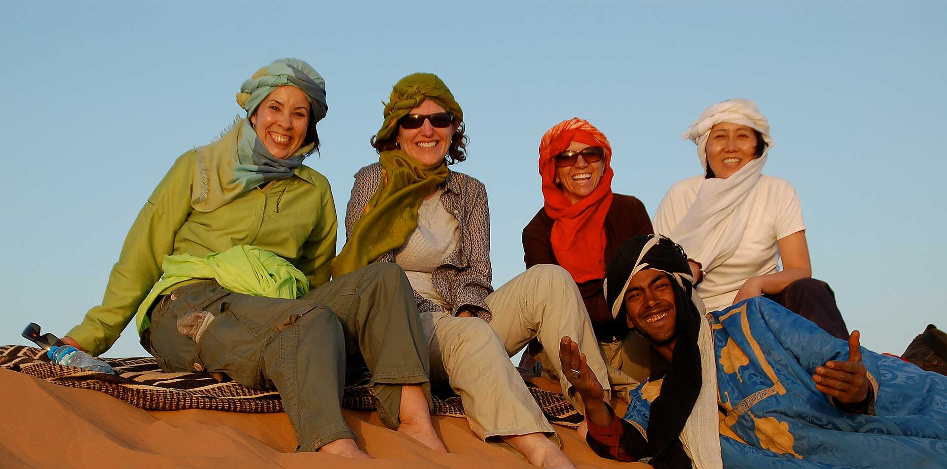 People Sitting on Sand Dune in Morocco