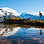 Oceania New Zealand man hiking at Aoraki Mount Cook National Park - luxury vacation destinations