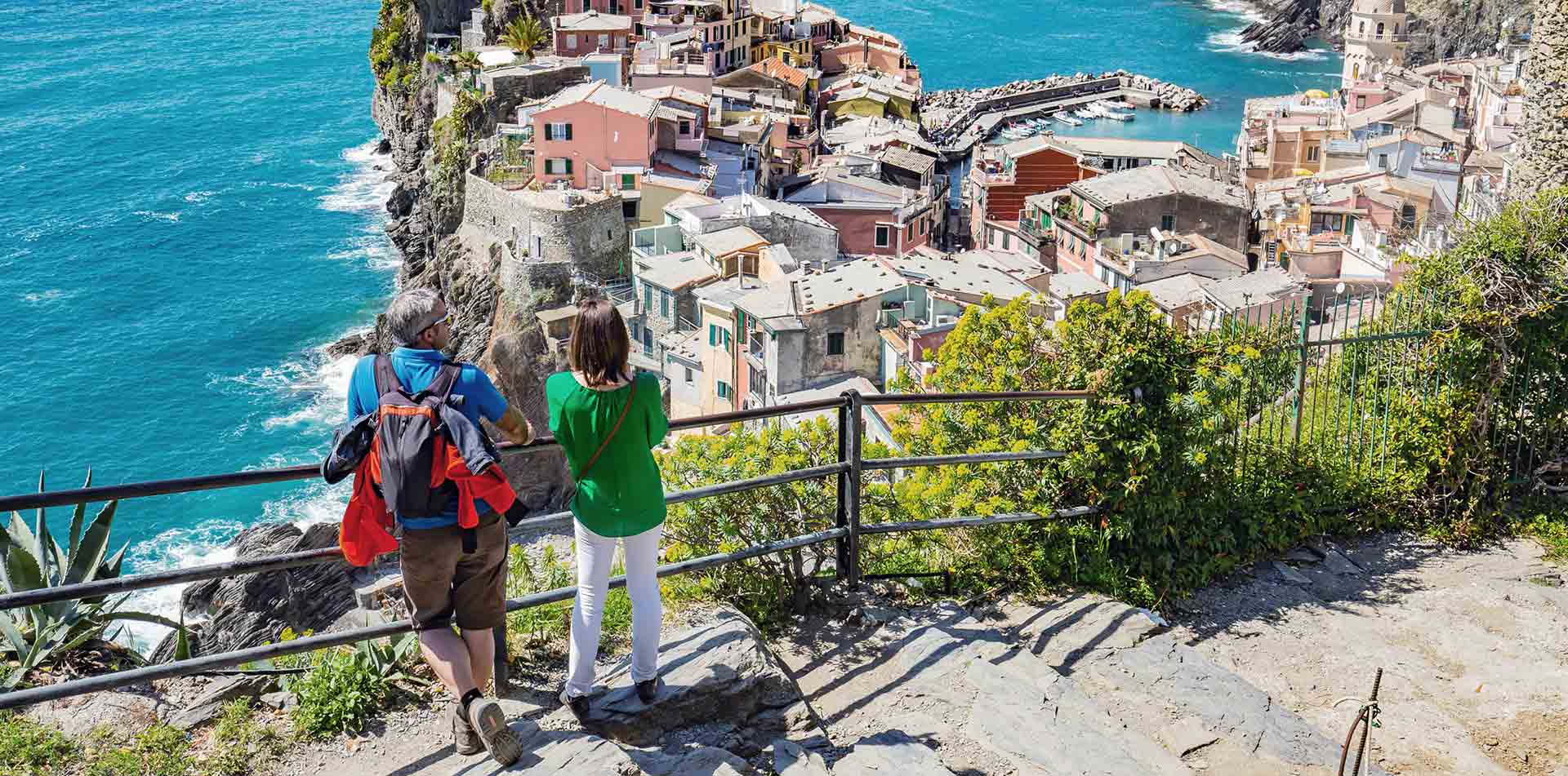 Europe Italy Liguria couple enjoying the view of Cinque Terra from above - luxury vacation destinations