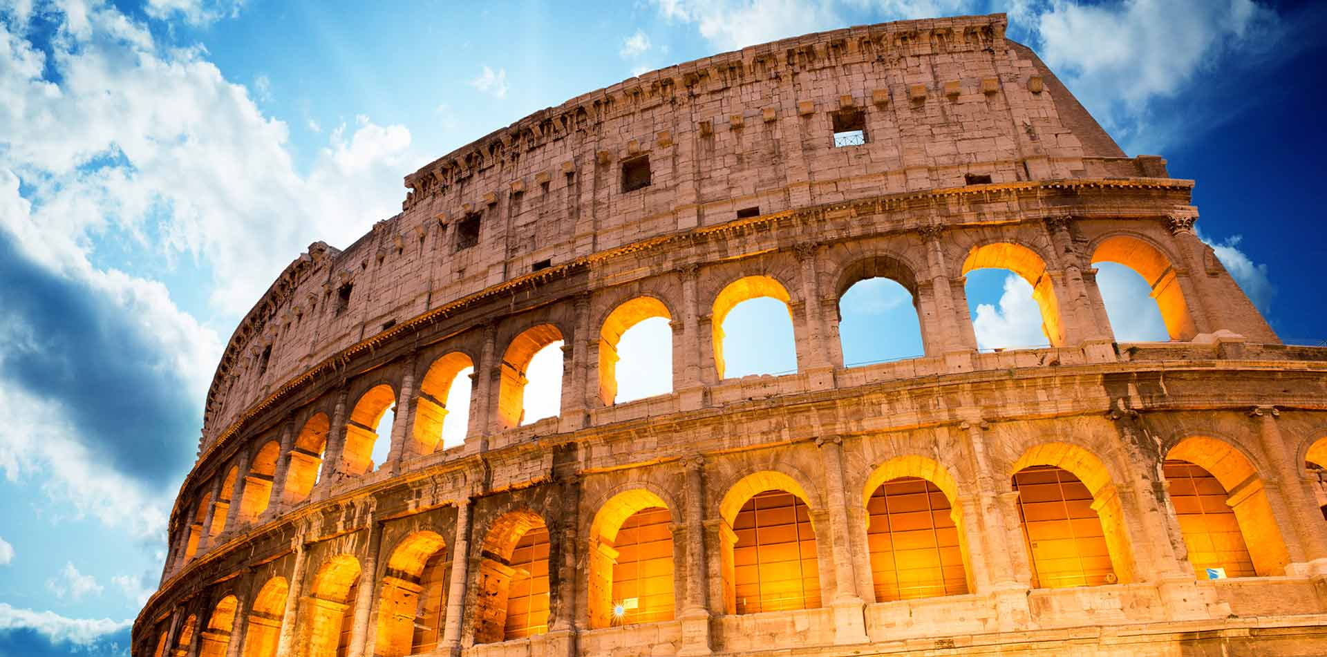 Europe Italy Rome ancient Colosseum oval amphitheatre bright sunlight - luxury vacation destinations
