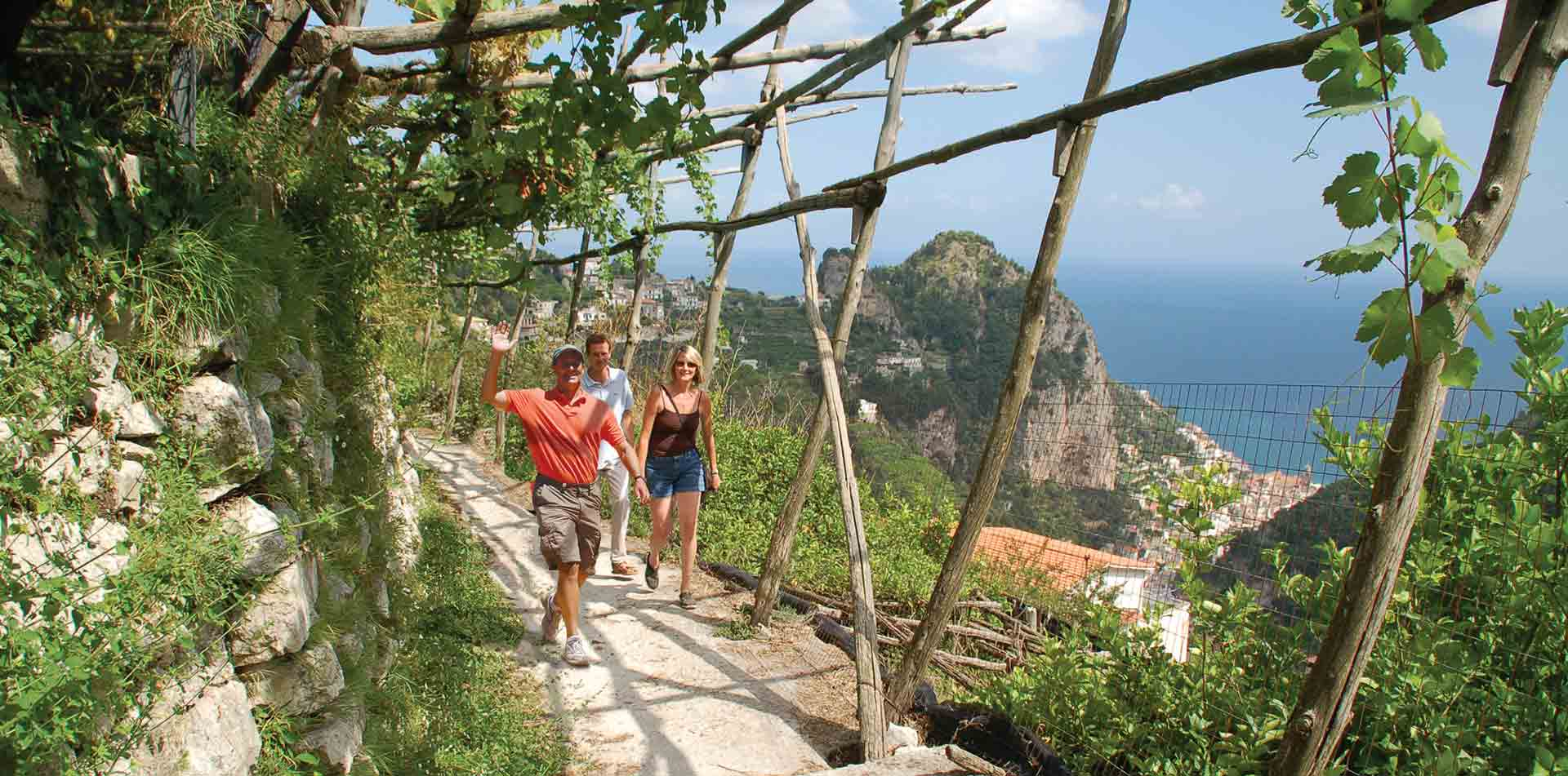 Europe Italy Amalfi Coast Capri Naples beautiful cliffside trail couple and local guide - luxury vacation destinations