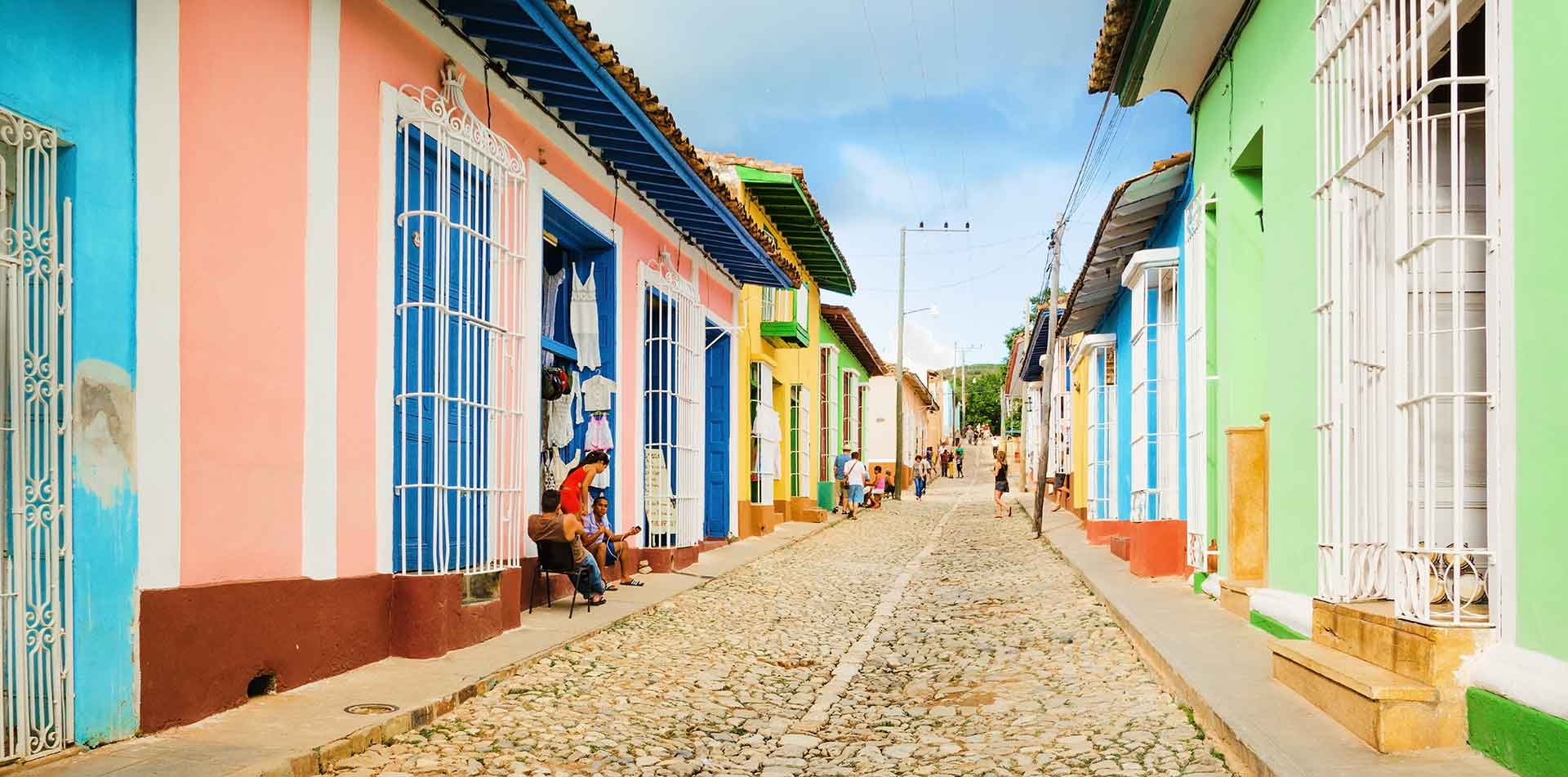 North America Caribbean Cuba Trinidad local old city colorful vibrant pastel street buildings - luxury vacation destinations