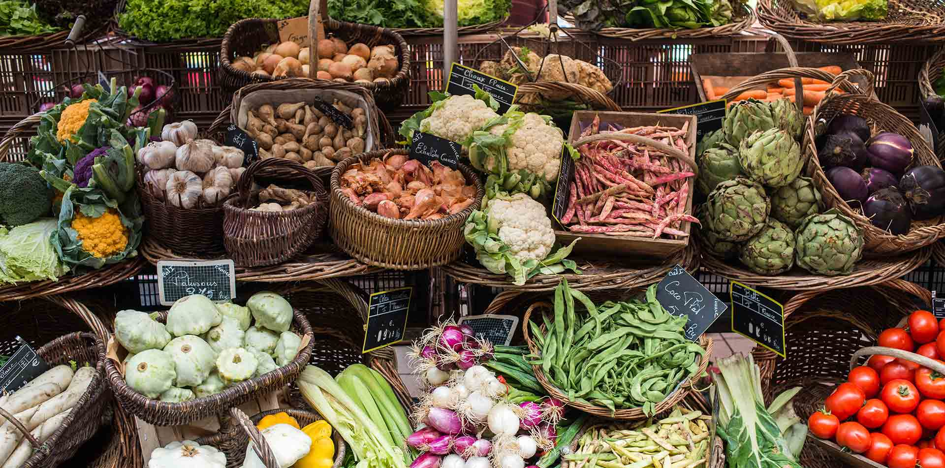 Europe France Dordogne fresh fruit and vegetable stand in local market - luxury vacation destinations