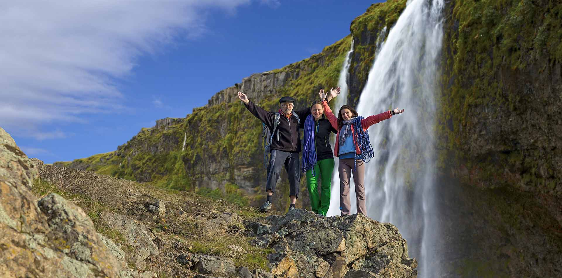 Group in front of waterfall, Iceland
