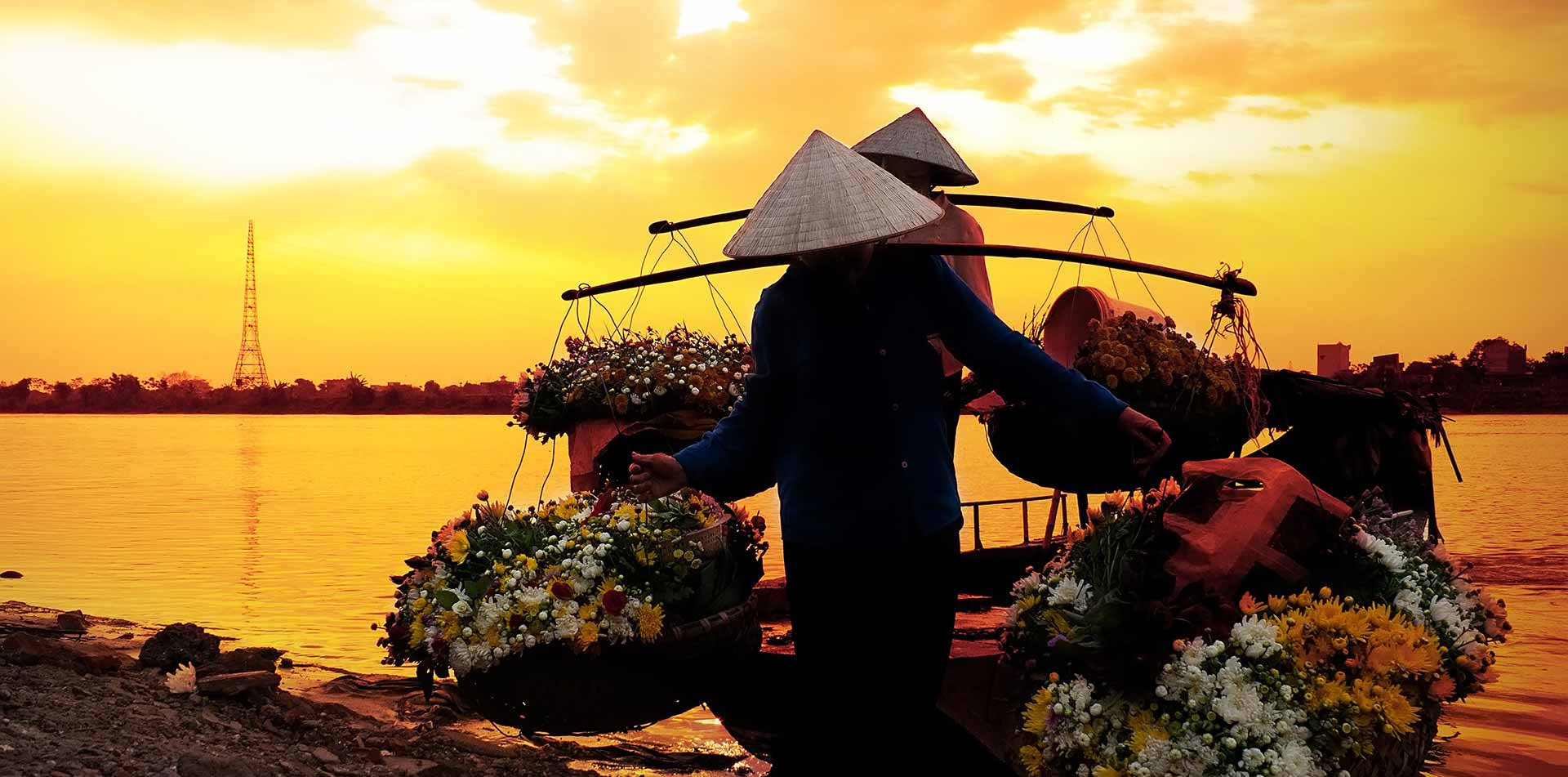Locals carrying flowers, Vietnam