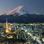 Asia Japan Tokyo cityscape at night with snow-topped Mount Fuji in the background - luxury vacation destinations